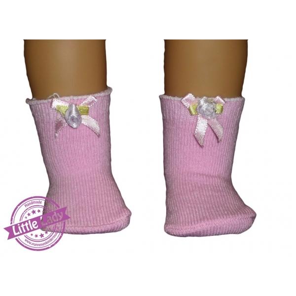 Roze sokjes met strik en roosje